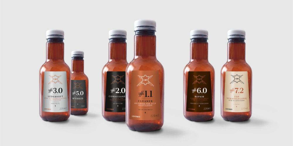 Flaschen von Ledermax mit Etiketten